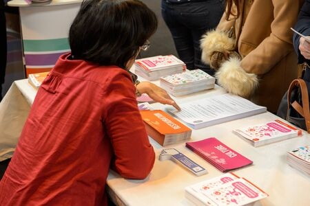 career path: STRASBOURG, FRANCE - FEB 4, 2016: Children and teens of all ages attending annual Education Fair to choose career path and receive vocational counseling - mentor giving advice