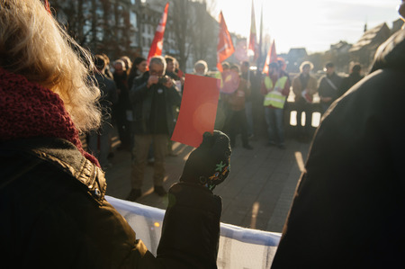 precarious: STRASBOURG, FRANCE - FEB 6, 2016: Protesters showing red carton for the government during a demonstration against governments plan to extent the state of emergency and for opened borders - Editorial