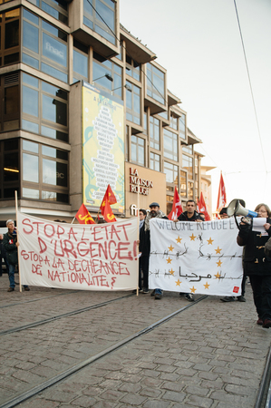 precarious: STRASBOURG, FRANCE - FEB 6, 2016: Protesters marching during a demonstration against governments plan to extent the state of emergency and for opened borders - holding welcome refugees banners Editorial