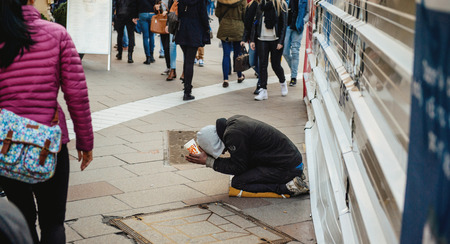 unneeded: STRASBOURG, FRANCE - FEB 6, 2016: Beggar in the street of the European Capital - Strasbourg, Alsace, France