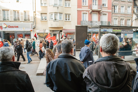 french ethnicity: STRASBOURG, FRANCE - FEB 6, 2016: Turkish ethnicity men looking at protesters marching during a demonstration against governments plan to extent the state of emergency and for opened borders -