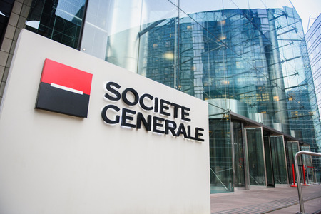 PARIS, FRANCE - DEC 3, 2014: Societe Generale Headquarter entrance in La Defense. The company is a universal bank and has divisions supporting French Networks, Global Transaction Banking, International Retail Banking, Financial services, Corporate and Inv