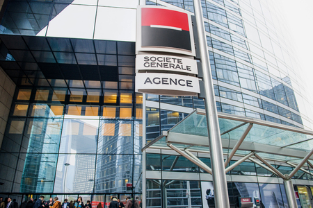 sg: PARIS, FRANCE - DEC 3, 2014: Societe Generale largest agency entrance in La Defense with people waiting to enter for loans and other services. The company is a universal bank and has divisions supporting French Networks, Global Transaction Banking, Intern