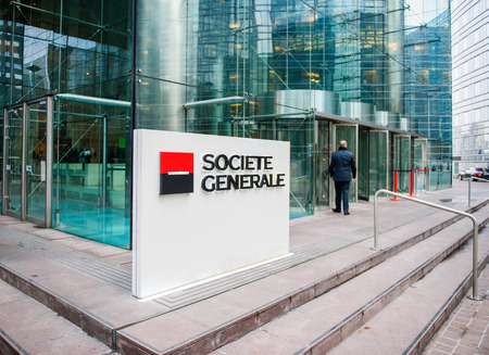 headquarter: PARIS, FRANCE - DEC 3, 2014: Businessman entering through the Societe Generale Headquarter entrance in La Defense. The company is a universal bank and has divisions supporting French Networks, Global Transaction Banking, International Retail Banking, Fina Editorial