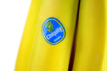 FRANKFURT, GERMANY - FEBRUARY 10, 2010: Miss Chiquita logotype on the fresh banana fruit on white background