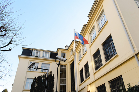 commision: STRASBOURG, FRANCE - DEC 25,2015: Surveillance cameras next to Russian Federation flag waving in front of Embassy of  Russia in Strasbourg, France Editorial