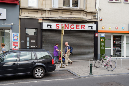 isaac: BRUSSELS, BELGIUM - AUG 30, 2015: Singer sewing store on street of Brussels. Singer Corporation is an American manufacturer of sewing machines, first established as I. M. Singer  Co. in 1851 by Isaac Merritt Singer with New York lawyer Edward Clark.