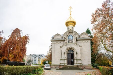 hallmark: BADEN, GERMANY - NOV 20, 2014: Facade of the Russian Orthodox Church in city of Baden-Baden. A glistening golden dome is the hallmark of this Byzantine-styled church, which should definitely be included on your tour of the town.  Vladimir Potemkin and Ber
