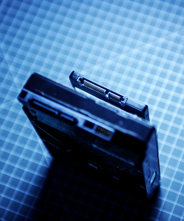 ssd: Hard disk next to ssd disk solid state drive blue technological background focus on contacts to emphasize the attention their connections