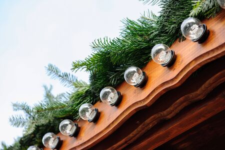 christmas decorations: LED bulb on Christmas market chalet during Christmas Market Stock Photo