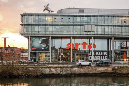 headquarter: STRASBOURG, FRANCE - MARCH 24, 2015: Arte Association Relative  la Tlvision Europenne television headquarter in Strasbourg with Je Susi charlie banner on facade. ARTE is a Franco-German TV network