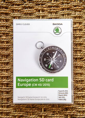 software box: FRANKFURT, GERMANY - FEBRUARY 22, 2016: Skoda Auto Navigation SD card software box with the SD card inside containing all European Maps for GPS navigation