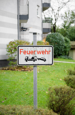 commanded: Feurwehr german street sign translated as Fire Department and no parking zone Stock Photo