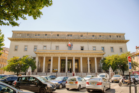 litigate: AIX-EN-PROVENCE, FRANCE - JUL 17, 2014: Cour dappel dAix-en-Provence Palace of Justice of Aix-en-Provence on a sunny day with cars and pedestrians. The Palace is located in Place de Verdun