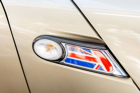 ire: United Kingdom flag as a decoration of a car light - The flag of the United Kingdom of Great Britain and Northern Ireland detail flag
