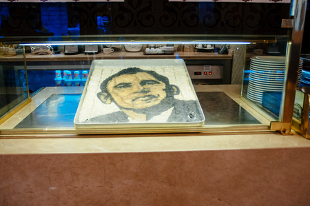 baklawa: ISTANBUl, TURKEY - JUL 28, 2009: Barack Obama face made from Turkish Baklava by Nidir Gullu Baklava shop in Istanbul, Turkey - iconic place attended by President of the United State in 2009