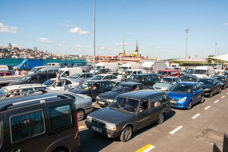 drivers: ISTANBUl, TURKEY - JUL 28, 2011: Cars and drivers waiting to enter the ferry to cross the sea in Istanbul port