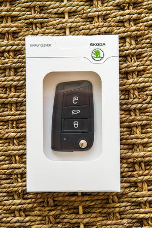 kodiak: FRANKFURT, GERMANY - FEBRUARY 22, 2016: Skoda Auto new car key in branded gift box agains natural bacground