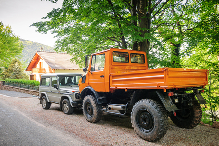 freightliner: FRANCE - MAY 10, 2015: Rear view of Unimog four wheel drive vehicle and Mercedes-Benz G-Class G-Wagen short for Gelandewagen,  Editorial
