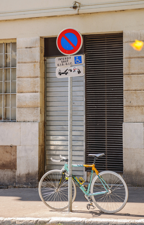 streetsign: AIX-EN-PROVENCE, FRANCE - JUL 17, 2014: Bianchi high performance bike parked on a street-sign on the street of Marseilles.