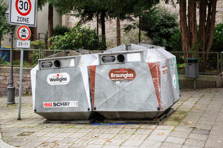 environmental concern: BADEN-BADEN, GERMANY - NOV 20, 2014: Bottle bank for white glass and braun glass on the streets of Baden-Baden, Germany Editorial