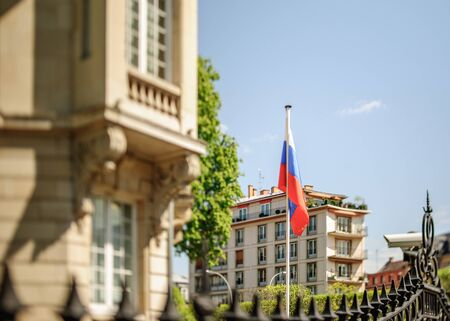 tilt and shift: Russian Federation flag waving in front of Consulate of Russia in Strasbourg, France. Tilt shift lens used to accent the flag for more natural effect