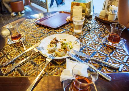 baklawa: Friends eating Turkish baklava and Turkis tea in traditional Turkish cafe