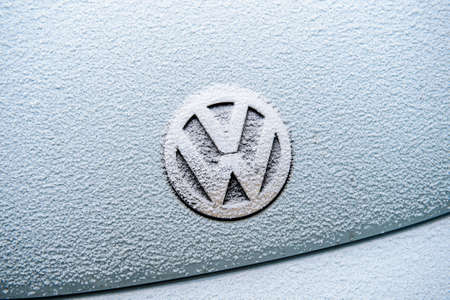 vw: PARIS, FRANCE - JAN 20, 2016: Volkswagen VW logotype covered with snow flakes. On 18 September 2015, the United States Environmental Protection Agency EPA issued a notice of violation