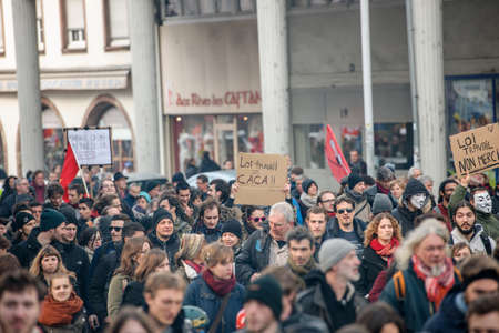 socialist: STRASBOURG, FRANCE - 9 MAR 2016: Crowd marching with Communist flags as thousands of people demonstrate as part of nationwide day of protest against proposed labor reforms by Socialist Government