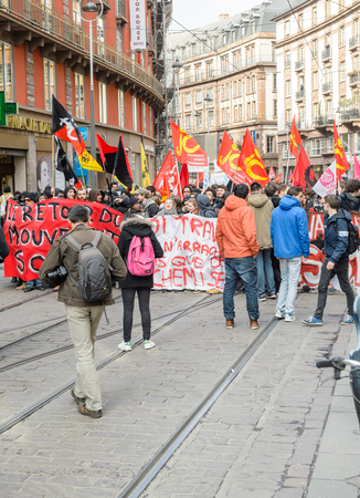 proposed: STRASBOURG, FRANCE - 9 MAR 2016: Blocked tramwaylines as thousands of people demonstrate as part of nationwide day of protest against proposed labor reforms by Socialist Government