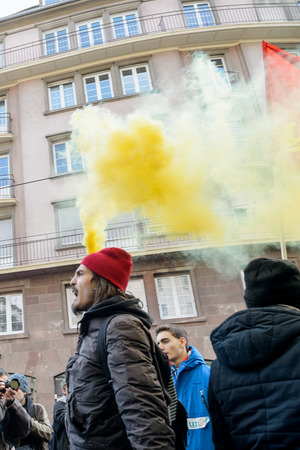 socialist: STRASBOURG, FRANCE - 9 MAR 2016: People burn flares and smokes grenade as thousands of people demonstrate as part of nationwide day of protest against proposed labor reforms by Socialist Government
