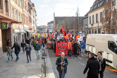 socialist: STRASBOURG, FRANCE - 9 MAR 2016: Crowd marching on the Rue du Vieux Marche aux Poissons as part of nationwide day of protest against proposed labor reforms by Socialist Government