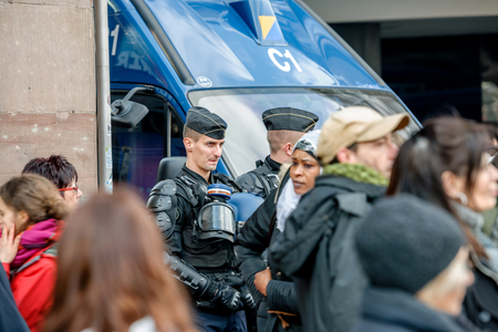 reforms: STRASBOURG, FRANCE - 9 MAR 2016: Police officers surveilling street as thousands of people demonstrate as part of nationwide day of protest against proposed labor reforms by Socialist Government
