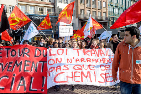 reforms: STRASBOURG, FRANCE - 9 MAR 2016: Thousands of people demonstrate in Place Kleber as part of nationwide day of protest against proposed labor reforms by Socialist Government