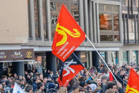 nationwide: STRASBOURG, FRANCE - 9 MAR 2016: Communist flag waving as thousands of people demonstrate as part of nationwide day of protest against proposed labor reforms by Socialist Government