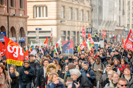 nationwide: STRASBOURG, FRANCE - 9 MAR 2016: Large crowd perspective of thousands of people demonstrating as part of nationwide day of protest against proposed labor reforms by Socialist Government