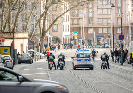 nationwide: STRASBOURG, FRANCE - 9 MAR 2016: French police blocking and surveilling street as thousands of people demonstrate as part of nationwide day of protest against proposed labor reforms by Socialist Government Editorial