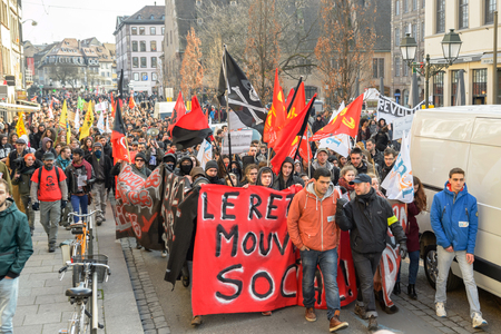 proposed: STRASBOURG, FRANCE - 9 MAR 2016: Crowd marching on the Rue du Vieux Marche aux Poissons as part of nationwide day of protest against proposed labor reforms by Socialist Government