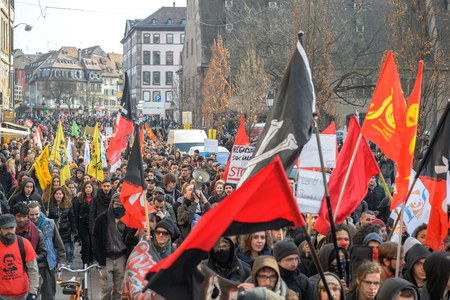 nationwide: STRASBOURG, FRANCE - 9 MAR 2016: Crowd marching on the Rue du Vieux Marche aux Poissons as part of nationwide day of protest against proposed labor reforms by Socialist Government