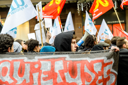 reforms: STRASBOURG, FRANCE - 9 MAR 2016: Man holding placard as thousands of people demonstrate as part of nationwide day of protest against proposed labor reforms by Socialist Government Editorial