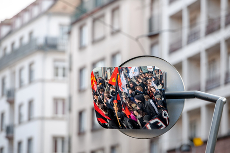 nationwide: STRASBOURG, FRANCE - 9 MAR 2016: Reflection in street tramway mirror as thousands of people demonstrate as part of nationwide day of protest against proposed labor reforms by Socialist Government Editorial