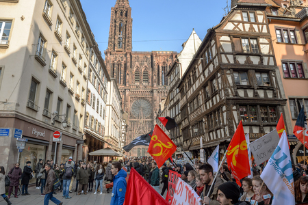 nationwide: STRASBOURG, FRANCE - 9 MAR 2016: Thousands of people demonstrate in front of Strasbourg Notre-Dame cathedral as part of nationwide day of protest against proposed labor reforms by Socialist Government Editorial