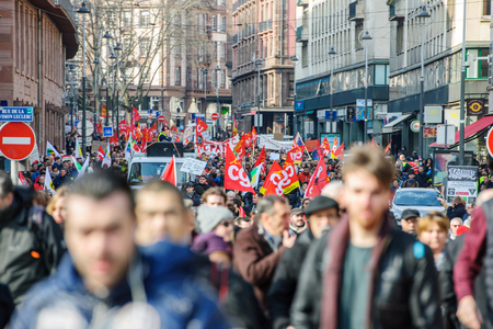 socialist: STRASBOURG, FRANCE - 9 MAR 2016: Thousands of people demonstrate as part of nationwide day of protest against proposed labor reforms by Socialist Government in the center of Strasbourg