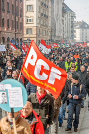 socialist: STRASBOURG, FRANCE - 9 MAR 2016: Large crowd perspective of thousands of people demonstrating as part of nationwide day of protest against proposed labor reforms by Socialist Government