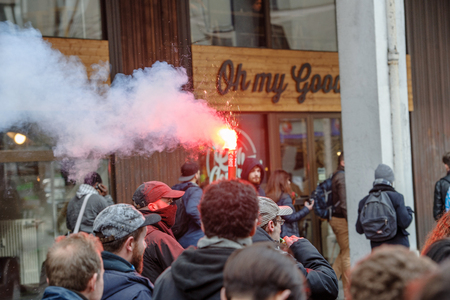 proposed: STRASBOURG, FRANCE - 9 MAR 2016: People burn flares and smokes grenade as thousands of people demonstrate as part of nationwide day of protest against proposed labor reforms by Socialist Government