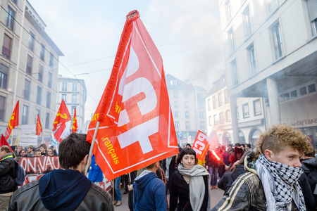 proposed: STRASBOURG, FRANCE - 9 MAR 2016: Thousands of people protesting in the center of Strasbourg with flags and smoke grenades as part of nationwide  protests against proposed labor reforms by Socialist Government