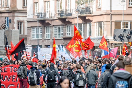 proposed: STRASBOURG, FRANCE - 9 MAR 2016: Media in front of  front row crowd as thousands of people demonstrate as part of nationwide day of protest against proposed labor reforms by Socialist Government Editorial
