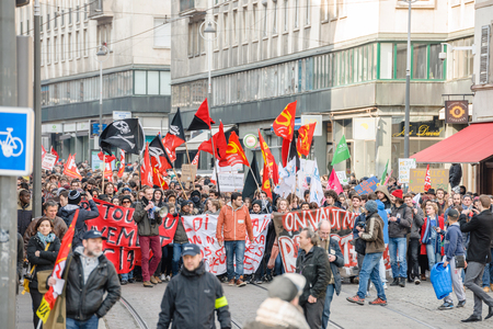 socialist: STRASBOURG, FRANCE - 9 MAR 2016: Young people blocking street as thousands of people demonstrate as part of nationwide day of protest against proposed labor reforms by Socialist Government Editorial