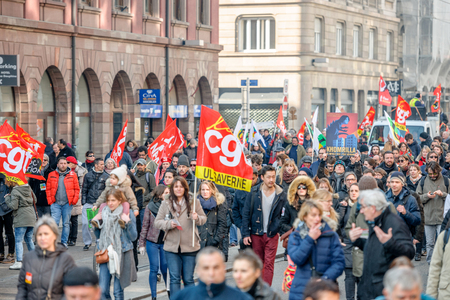 syndicate: STRASBOURG, FRANCE - 9 MAR 2016: Large crowd perspective of thousands of people demonstrating as part of nationwide day of protest against proposed labor reforms by Socialist Government