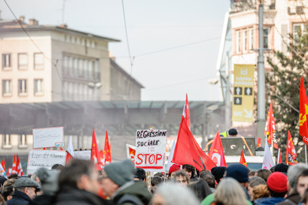 regression: STRASBOURG, FRANCE - 9 MAR 2016: Social regression - we say stop placard as thousands of people demonstrate as part of nationwide day of protest against proposed labor reforms by Socialist Government Editorial
